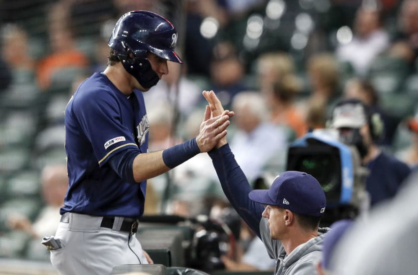 HOUSTON, TX - JUNE 11: Craig Counsell #30 of the Milwaukee Brewers congratulates Christian Yelich #22 after scoring in the first inning against the Houston Astros at Minute Maid Park on June 11, 2019 in Houston, Texas. (Photo by Tim Warner/Getty Images)