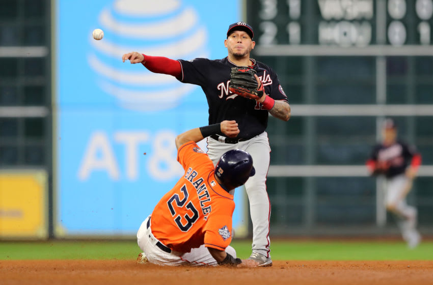 HOUSTON, TEXAS - OCTOBER 30: Asdrubal Cabrera #13 of the Washington Nationals gets the out at second base against Michael Brantley #23 of the Houston Astros during the fifth inning in Game Seven of the 2019 World Series at Minute Maid Park on October 30, 2019 in Houston, Texas. (Photo by Elsa/Getty Images)