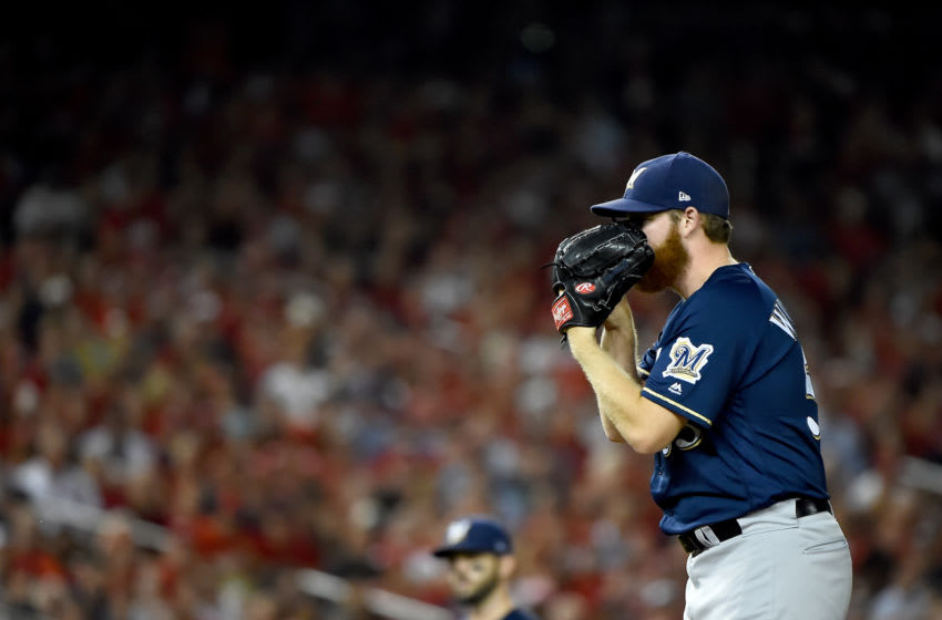 WASHINGTON, DC - OCTOBER 01: Brandon Woodruff #53 of the Milwaukee Brewers throws a pitch against the Washington Nationals during the first inning in the National League Wild Card game at Nationals Park on October 01, 2019 in Washington, DC. (Photo by Will Newton/Getty Images)