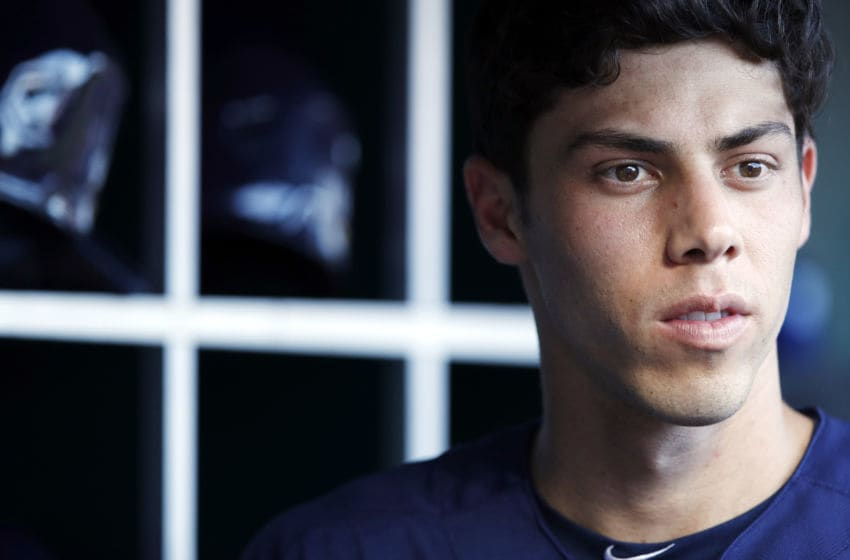 CINCINNATI, OH - JULY 01: Christian Yelich #22 of the Milwaukee Brewers looks on while preparing to bat in the first inning against the Cincinnati Reds at Great American Ball Park on July 1, 2019 in Cincinnati, Ohio. (Photo by Joe Robbins/Getty Images)