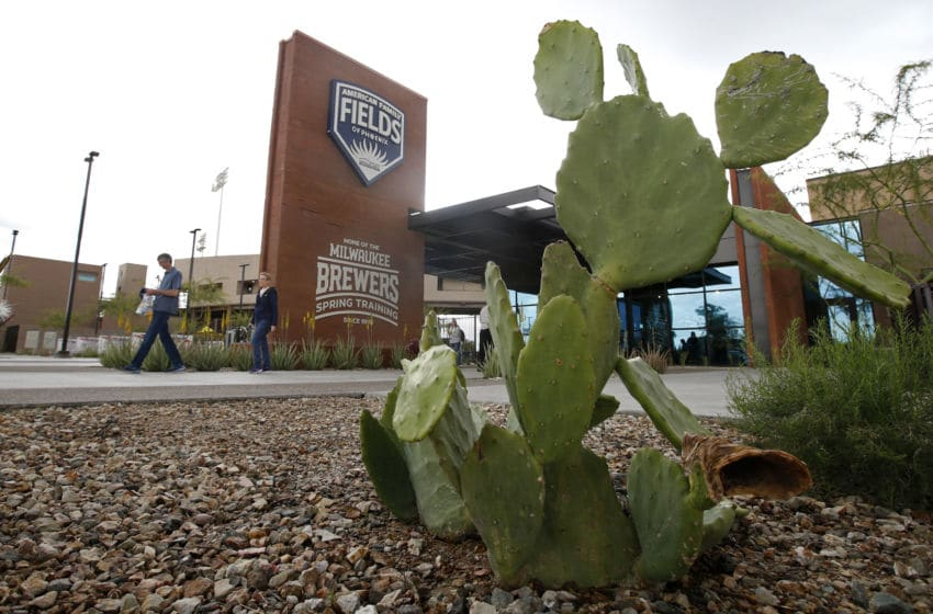 MARYVALE, - MARCH 12: Fans walk from American Family Fields stadium, spring training home of the Milwaukee Brewers, following Major League Baseball's decision to suspend all spring training games on March 12, 2020 in Phoenix, Arizona. The decision was made due to concerns of the ongoing Coronavirus (COVID-19) outbreak. (Photo by Ralph Freso/Getty Images)