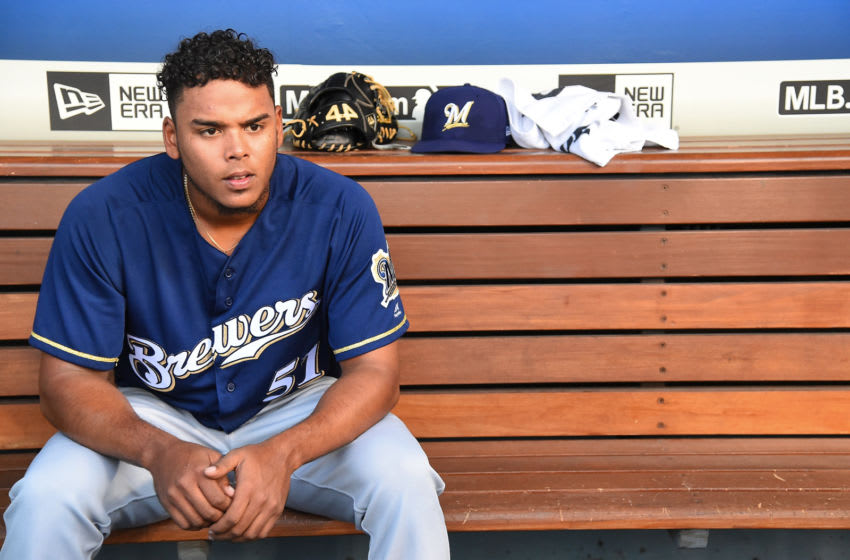 LOS ANGELES, CA - JULY 30: Freddy Peralta #51 of the Milwaukee Brewers sits in the dugout during the game against the Los Angeles Dodgers at Dodger Stadium on July 30, 2018 in Los Angeles, California. (Photo by Jayne Kamin-Oncea/Getty Images)