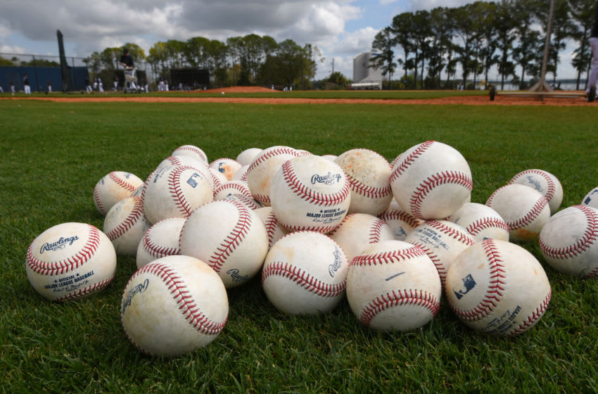 LAKELAND, FL - FEBRUARY 17: A detailed view of a group of Rawlings official Major League baseballs sitting on the field during the Detroit Tigers Spring Training workouts at the TigerTown Facility on February 17, 2020 in Lakeland, Florida. (Photo by Mark Cunningham/MLB Photos via Getty Images)