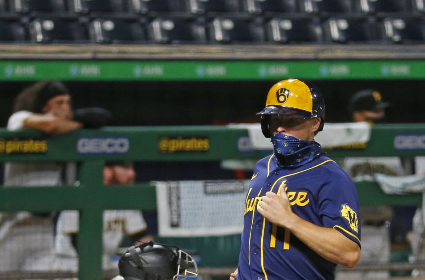 PITTSBURGH, PA - JULY 27: Brock Holt #11 of the Milwaukee Brewers scores on an RBI double in the eleventh inning against the Pittsburgh Pirates during Opening Day at PNC Park on July 27, 2020 in Pittsburgh, Pennsylvania. (Photo by Justin K. Aller/Getty Images)