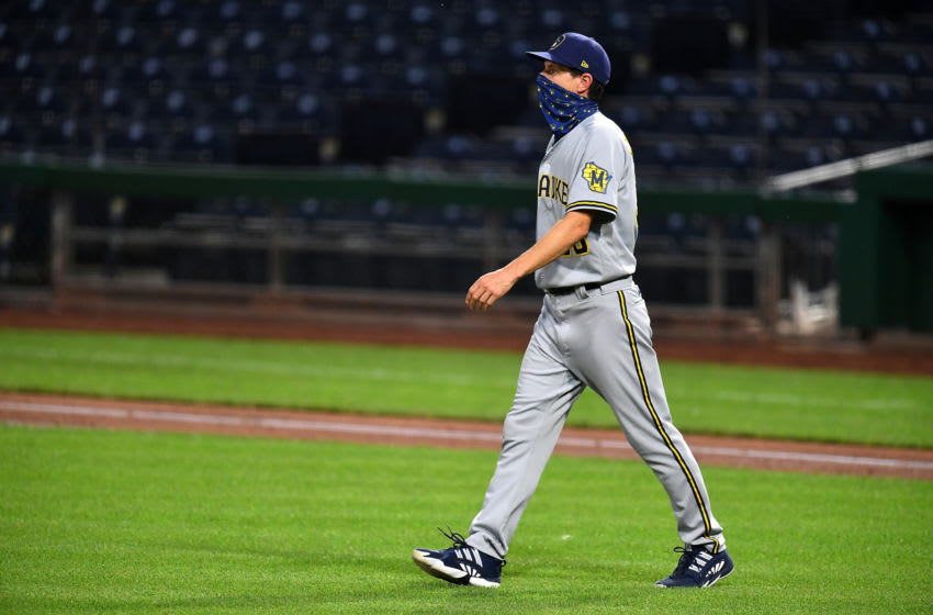PITTSBURGH, PA - JULY 28: Manager Craig Counsell #30 of the Milwaukee Brewers walks to the mound during the fifth inning agains the Pittsburgh Pirates at PNC Park on July 28, 2020 in Pittsburgh, Pennsylvania. (Photo by Joe Sargent/Getty Images)