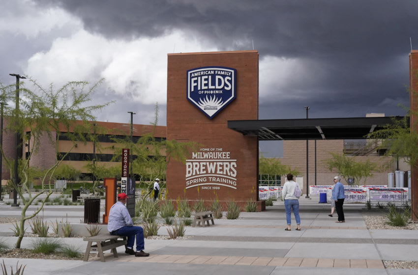 Mar 13, 2020; Phoenix, Arizona, USA; Fans walk around American Family Fields of Phoenix following the cancellation of a spring training game between the Cleveland Indians and Milwaukee Brewers due to the Covid 19 coronavirus outbreak. Major League Baseball is also delaying the start of the regular season by at least two weeks Mandatory Credit: Rick Scuteri-USA TODAY Sports