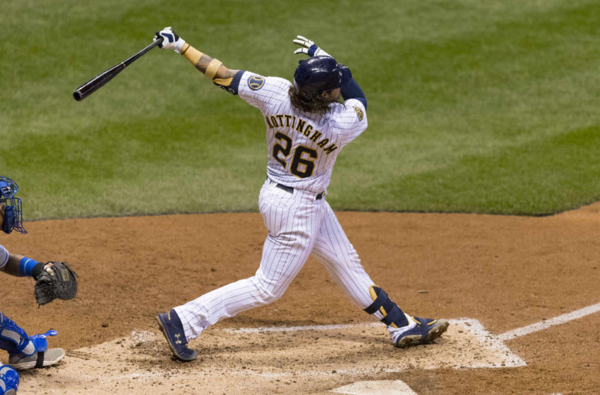 Sep 18, 2020; Milwaukee, Wisconsin, USA; Milwaukee Brewers catcher Jacob Nottingham (26) hits a grand slam home run during the fourth inning against the Kansas City Royals at Miller Park. Mandatory Credit: Jeff Hanisch-USA TODAY Sports