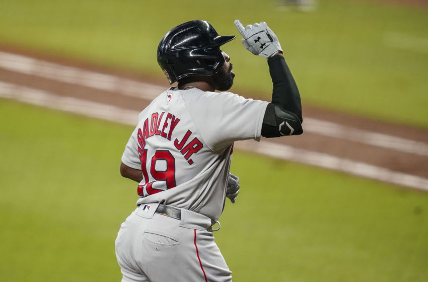 Sep 25, 2020; Cumberland, Georgia, USA; Boston Red Sox center fielder Jackie Bradley Jr. (19) reacts after hitting a home run against the Atlanta Braves during the fifth inning at Truist Park. Mandatory Credit: Dale Zanine-USA TODAY Sports