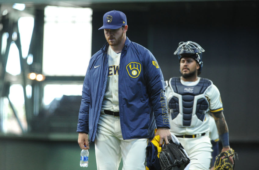 Apr 1, 2021; Milwaukee, Wisconsin, USA; Milwaukee Brewers starting pitcher Brandon Woodruff (53) and catcher Milwaukee Brewers catcher Omar Narvaez (10) walk in from the bullpen prior to the start of their game with the Minnesota Twins at American Family Field. Mandatory Credit: Michael McLoone-USA TODAY Sports