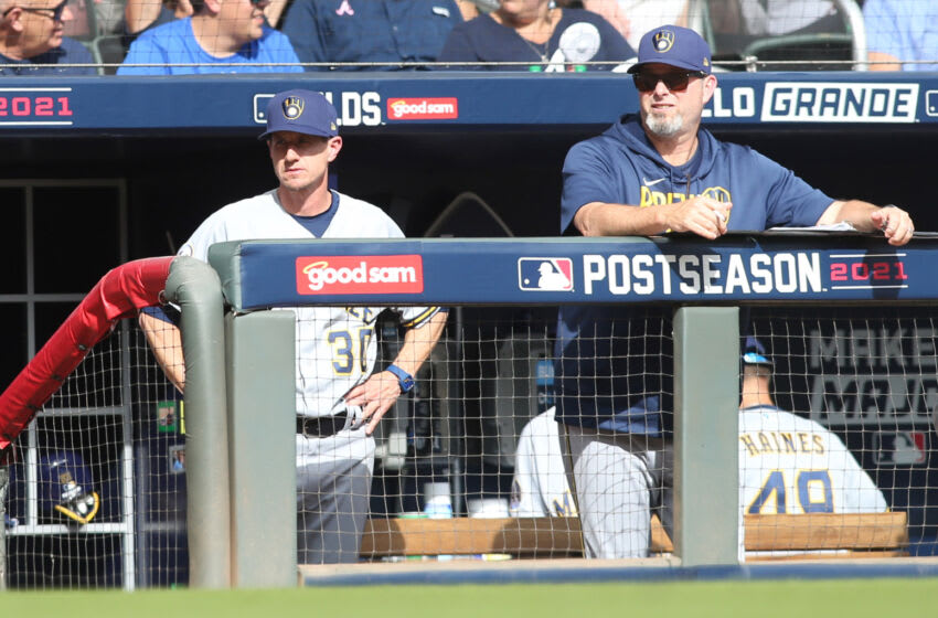 Oct 11, 2021; Cumberland, GA, USA; Milwaukee Brewers manager Craig Counsell (30) looks out from the dugout against the Atlanta Braves during the seventh inning during game three of the 2021 ALDS at Truist Park. Mandatory Credit: Brett Davis-USA TODAY Sports