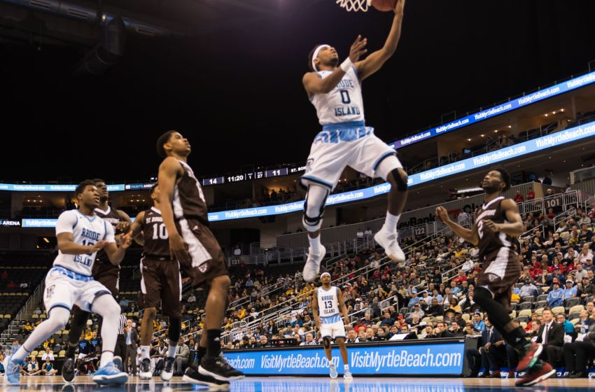 PITTSBURGH, PA - MARCH 10: E.C. Matthews #0 of the Rhode Island Rams scores against the St. Bonaventure Bonnies at PPG Paints Arena on March 10, 2017 in Pittsburgh, Pennsylvania. (Photo by Friday / photobyfriday.com)