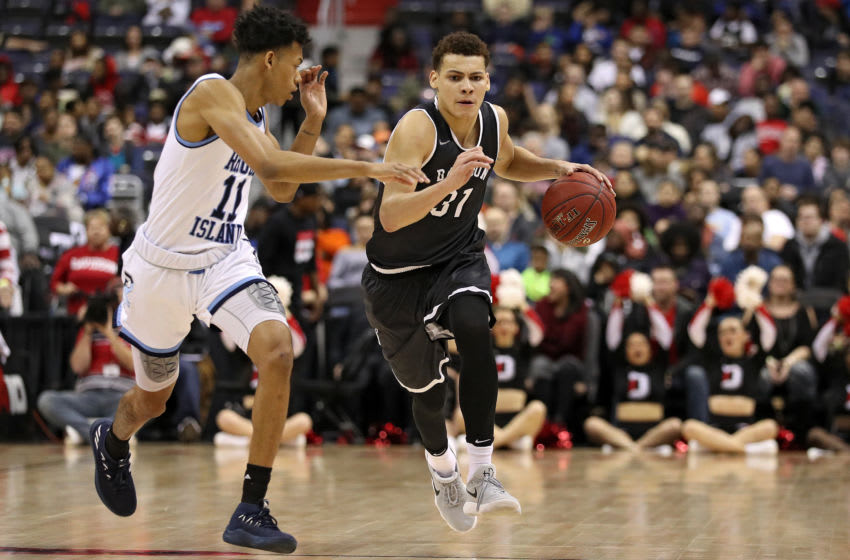 WASHINGTON, DC - MARCH 11: Kellan Grady #31 of the Davidson Wildcats dribbles past Jeff Dowtin #11 of the Rhode Island Rams during the first half in the Championship of the Atlantic 10 Basketball Tournament at Capital One Arena on March 11, 2018 in Washington, DC. (Photo by Patrick Smith/Getty Images)