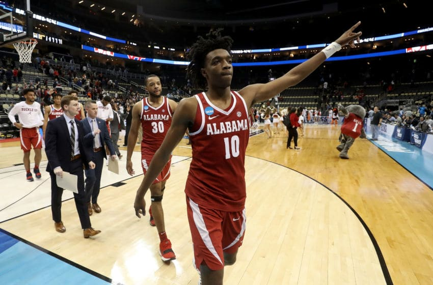 PITTSBURGH, PA - MARCH 15: Herbert Jones #10 and Galin Smith #30 of the Alabama Crimson Tide celebrate after defeating the Virginia Tech Hokies in the game in the first round of the 2018 NCAA Men's Basketball Tournament at PPG PAINTS Arena on March 15, 2018 in Pittsburgh, Pennsylvania. (Photo by Rob Carr/Getty Images)