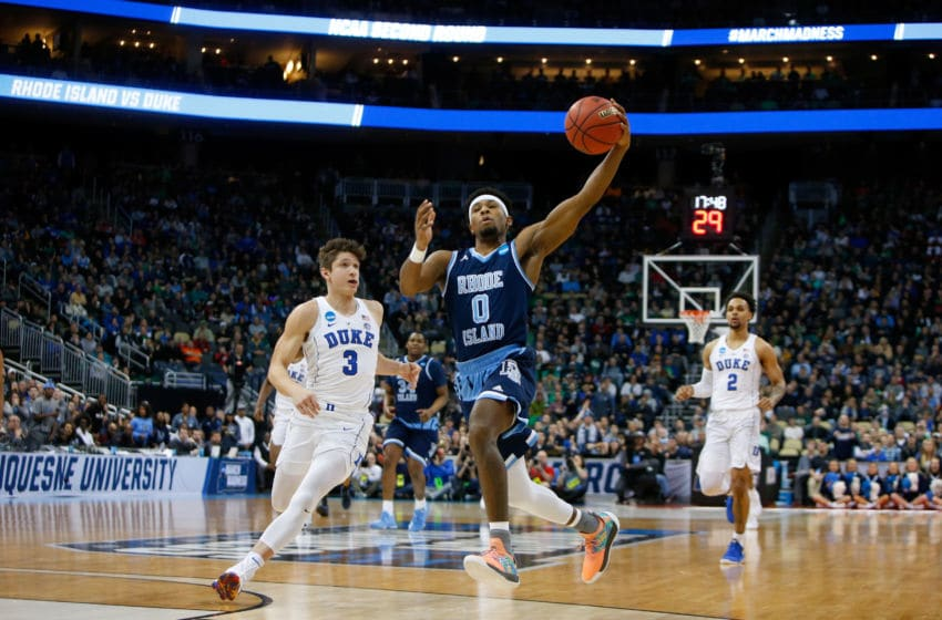 PITTSBURGH, PA - MARCH 17: E.C. Matthews #0 of the Rhode Island Rams drives to the basket against Grayson Allen #3 of the Duke Blue Devils during the first half in the second round of the 2018 NCAA Men's Basketball Tournament at PPG PAINTS Arena on March 17, 2018 in Pittsburgh, Pennsylvania. (Photo by Justin K. Aller/Getty Images)