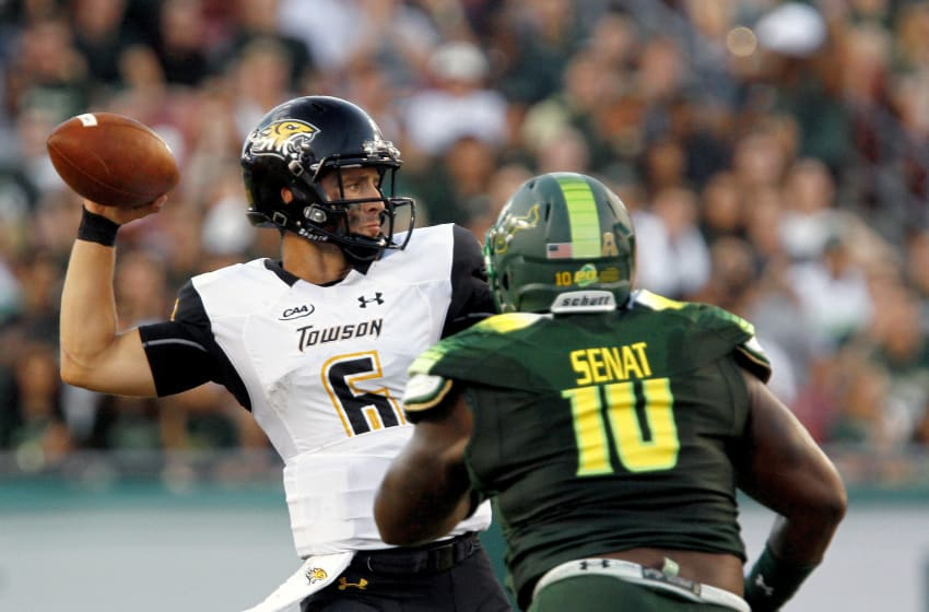 TAMPA, FL - SEPTEMBER 03: Quarterback Morgan Mahalak #6 of the Towson Tigers gets pressured by defensive tackle Deadrin Senat #10 of the South Florida Bulls during the first quarter of their game at Raymond James Stadium on September 3, 2016 in Tampa, Florida. (Photo by Joseph Garnett Jr. /Getty Images)