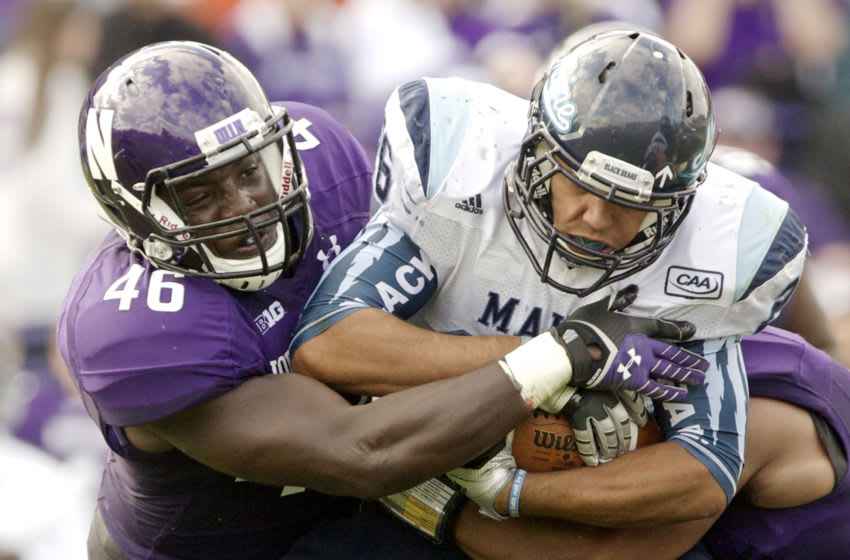 EVANSTON, IL - SEPTEMBER 21: Damien Proby #46 of the Northwestern Wildcats tackles Nigel Jones #26 of the Maine Black Bears during the second quarter of their college football game at Ryan Field on September 21, 2013 in Evanston, Illinois. (Photo by John Gress/Getty Images)