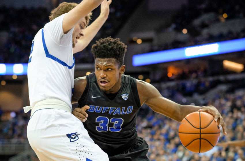 OMAHA, NEBRASKA-NOVEMBER 29: Nick Perkins #33 of the Buffalo Bulls tries to get by Toby Hegner #32 of the Creighton Bluejays during their game at the CenturyLink Center on November 29, 2016 in Omaha, Nebraska. (Photo by Eric Francis/Getty Images)