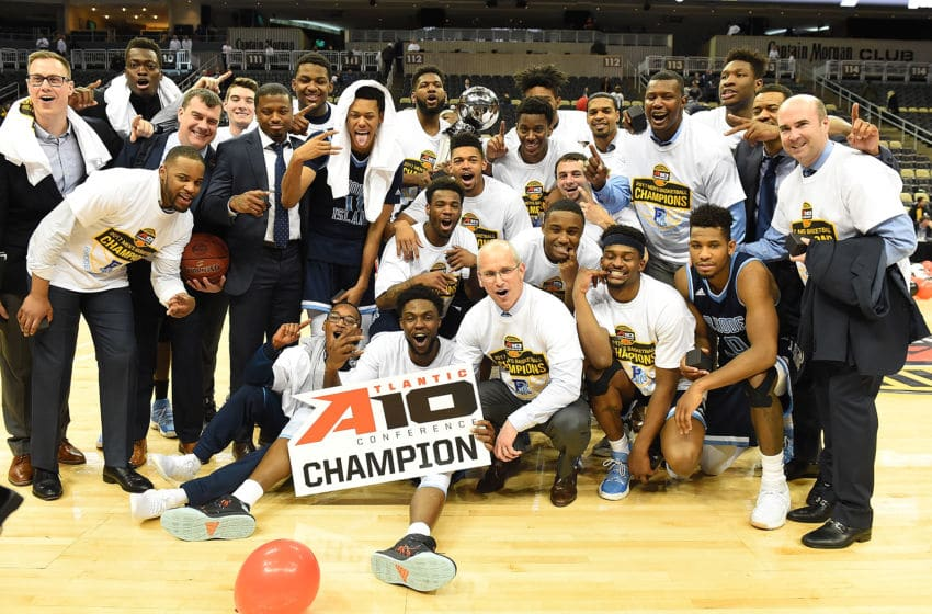 PITTSBURGH, PA - MARCH 12: The Rhode Island Rams celebrate after defeating the Virginia Commonwealth Rams 70-63 during the championship game of the Atlantic 10 Basketball Tournament at PPG PAINTS Arena on March 12, 2017 in Pittsburgh, Pennsylvania. (Photo by Joe Sargent/Getty Images)