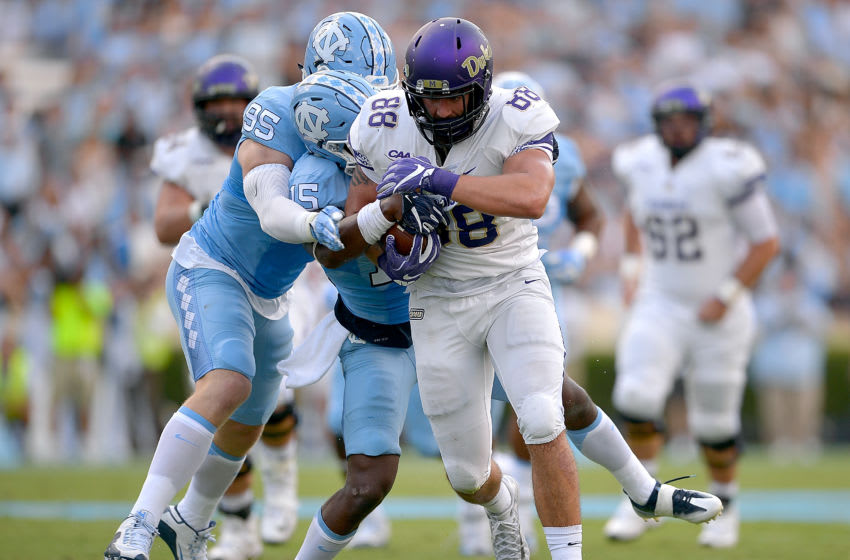 CHAPEL HILL, NC - SEPTEMBER 17: Tyler Powell #95 and Donnie Miles #15 of the North Carolina Tar Heels tackle Jonathan Kloosterman #88 of the James Madison Dukes during the game at Kenan Stadium on September 17, 2016 in Chapel Hill, North Carolina. (Photo by Grant Halverson/Getty Images)