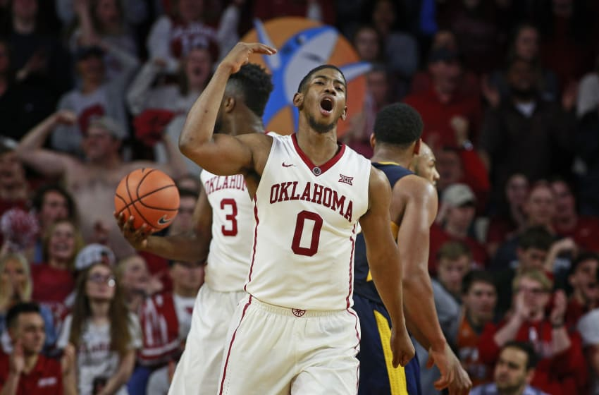 NORMAN, OK - FEBRUARY 05: Christian James #0 of the Oklahoma Sooners reacts after a score against the West Virginia Mountaineers at Lloyd Noble Center on February 5, 2018 in Norman, Oklahoma. West Virginia defeated Oklahoma 75-73. (Photo by Brett Deering/Getty Images)