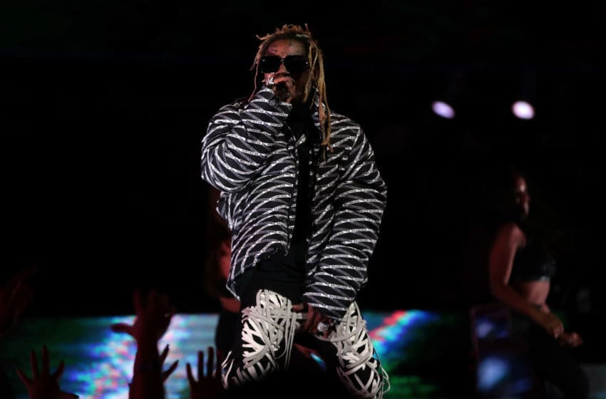CHICAGO, ILLINOIS - FEBRUARY 15: Lil Wayne performs in the 2020 NBA All-Star - AT&T Slam Dunk Contest during State Farm All-Star Saturday Night at the United Center on February 15, 2020 in Chicago, Illinois. NOTE TO USER: User expressly acknowledges and agrees that, by downloading and or using this photograph, User is consenting to the terms and conditions of the Getty Images License Agreement. (Photo by Jonathan Daniel/Getty Images)