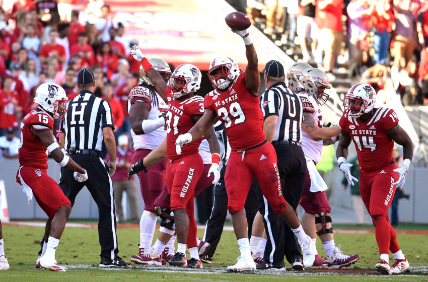 RALEIGH, NC - NOVEMBER 03: James Smith-Williams #39 of the North Carolina State Wolfpack reacts after recovering a fumble against the Florida State Seminoles at Carter-Finley Stadium on November 3, 2018 in Raleigh, North Carolina. (Photo by Lance King/Getty Images)