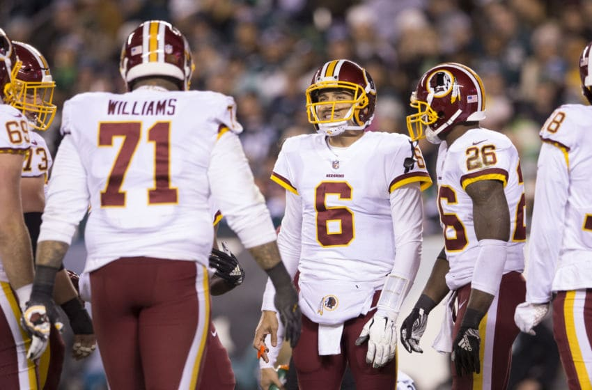 PHILADELPHIA, PA - DECEMBER 03: Trent Williams #71, Mark Sanchez #6, and Adrian Peterson #26 of the Washington Redskins huddle against the Philadelphia Eagles at Lincoln Financial Field on December 3, 2018 in Philadelphia, Pennsylvania. (Photo by Mitchell Leff/Getty Images)