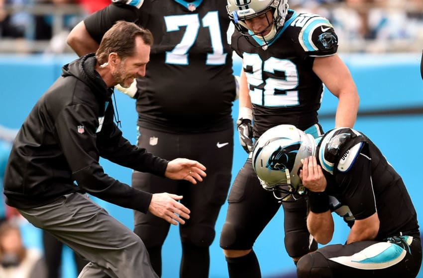 CHARLOTTE, NORTH CAROLINA - DECEMBER 23: Taylor Heinicke #6 of the Carolina Panthers injures his elbow against the Atlanta Falcons in the second quarter during their game at Bank of America Stadium on December 23, 2018 in Charlotte, North Carolina. (Photo by Grant Halverson/Getty Images)