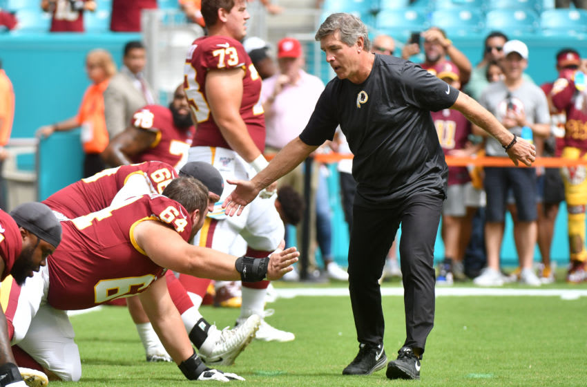 MIAMI, FL - OCTOBER 13: Head Coach Bill Callahan of the Washington Redskins shakes hands with Ross Pierschbacher #64 during pregame before the start of the game against the Miami Dolphins at Hard Rock Stadium on October 13, 2019 in Miami, Florida. (Photo by Eric Espada/Getty Images)