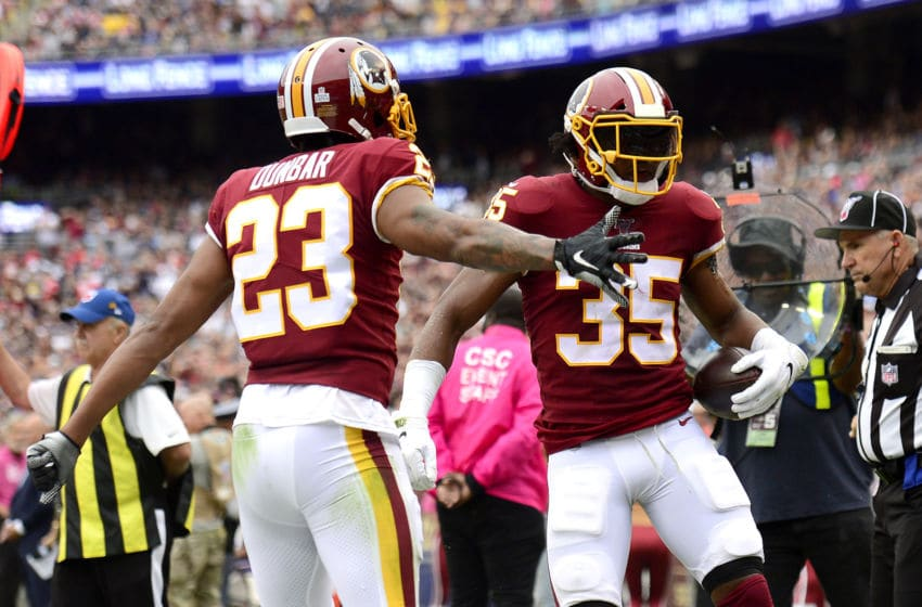 LANDOVER, MARYLAND - OCTOBER 06: Montae Nicholson #35 is congratulated by his teammate Quinton Dunbar #23 of the Washington Redskins after his interception against the New England Patriots during the second quarter in the game at FedExField on October 06, 2019 in Landover, Maryland. (Photo by Patrick McDermott/Getty Images)
