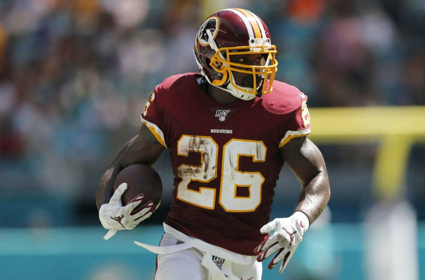 MIAMI, FLORIDA - OCTOBER 13: Adrian Peterson #26 of the Washington Football Team runs with the ball against the Miami Dolphins during the first quarter at Hard Rock Stadium on October 13, 2019 in Miami, Florida. (Photo by Michael Reaves/Getty Images)