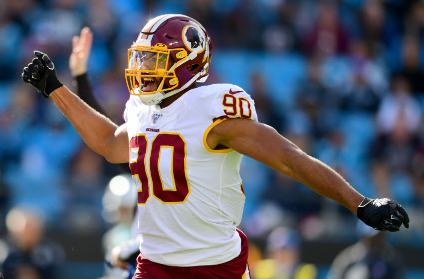CHARLOTTE, NORTH CAROLINA - DECEMBER 01: Montez Sweat #90 of the Washington Redskins reacts after a defensive stop during the first quarter during their game against the Carolina Panthers at Bank of America Stadium on December 01, 2019 in Charlotte, North Carolina. (Photo by Jacob Kupferman/Getty Images)