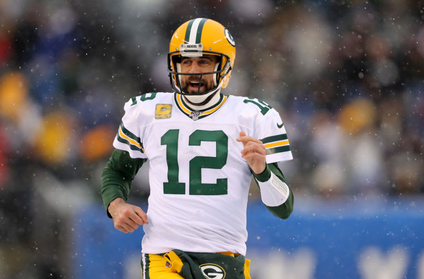 EAST RUTHERFORD, NEW JERSEY - DECEMBER 01: Aaron Rodgers #12 of the Green Bay Packers celebrates a touchdown in the first quarter against the New York Giants at MetLife Stadium on December 01, 2019 in East Rutherford, New Jersey. (Photo by Elsa/Getty Images)