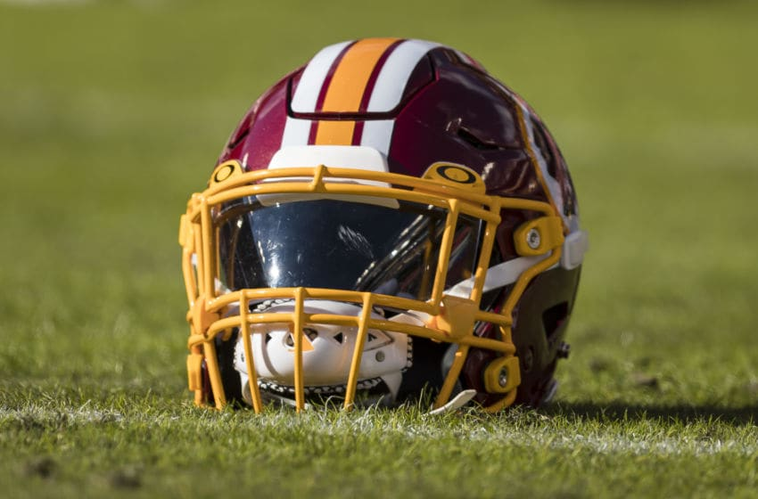 LANDOVER, MD - DECEMBER 15: A Washington football team helmet is seen on the field before the game between the Washington football team and the Philadelphia Eagles at FedExField on December 15, 2019 in Landover, Maryland. (Photo by Scott Taetsch/Getty Images)