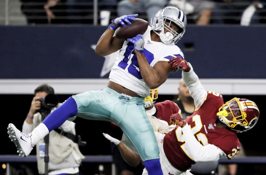 ARLINGTON, TEXAS - DECEMBER 29: Amari Cooper #19 of the Dallas Cowboys makes a catch while being guarded by Jimmy Moreland #32 of the Washington Redskins in the second quarter in the game at AT&T Stadium on December 29, 2019 in Arlington, Texas. (Photo by Ronald Martinez/Getty Images)