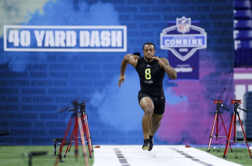 INDIANAPOLIS, IN - FEBRUARY 28: Running back AJ Dillon of Boston College runs the 40-yard dash during the NFL Combine at Lucas Oil Stadium on February 28, 2020 in Indianapolis, Indiana. (Photo by Joe Robbins/Getty Images)