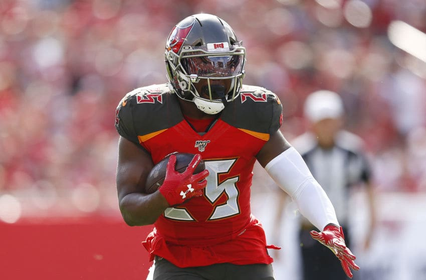 TAMPA, FLORIDA - DECEMBER 29: Peyton Barber #25 of the Tampa Bay Buccaneers runs with the ball against the Atlanta Falcons during the first half at Raymond James Stadium on December 29, 2019 in Tampa, Florida. (Photo by Michael Reaves/Getty Images)