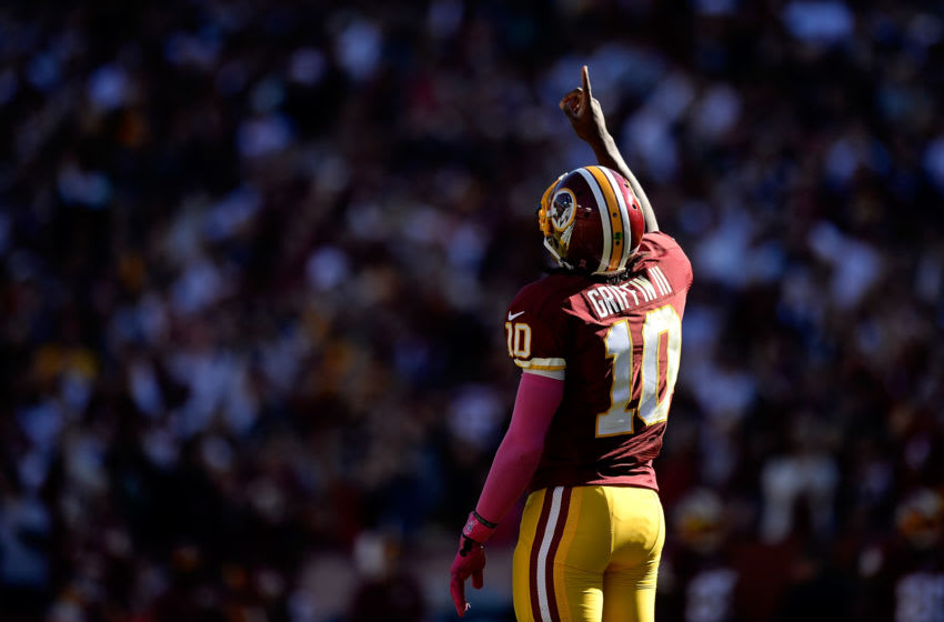 LANDOVER, MD - OCTOBER 20: Robert Griffin III #10 of the Washington Redskins celebrates after the Redskins scored a touchdown in the second half during an NFL game against the Chicago Bears at FedExField on October 20, 2013 in Landover, Maryland. (Photo by Patrick McDermott/Getty Images)