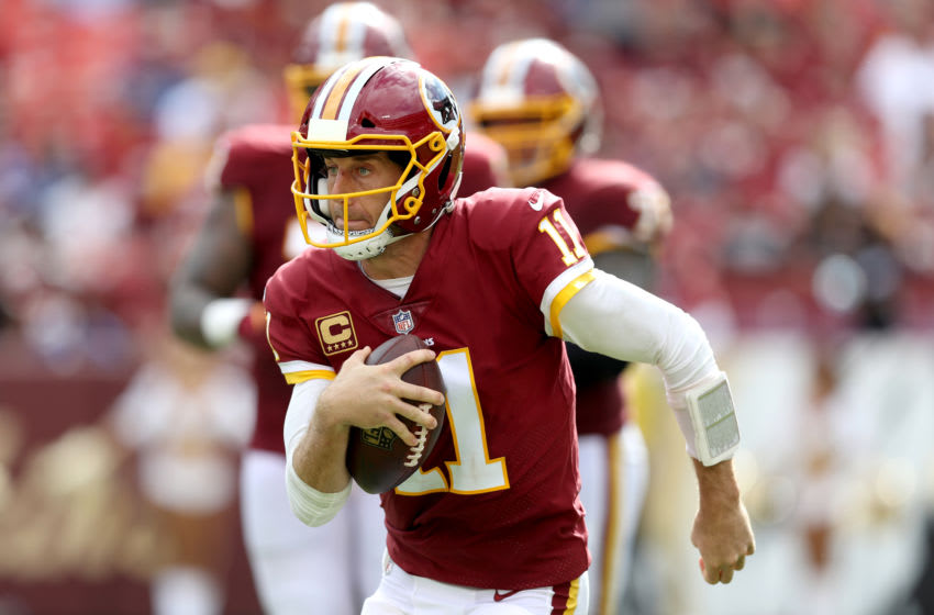 LANDOVER, MD - SEPTEMBER 16: Quarterback Alex Smith #11 of the Washington Redskins scrambles with the ball against the Indianapolis Colts in the second half at FedExField on September 16, 2018 in Landover, Maryland. (Photo by Rob Carr/Getty Images)