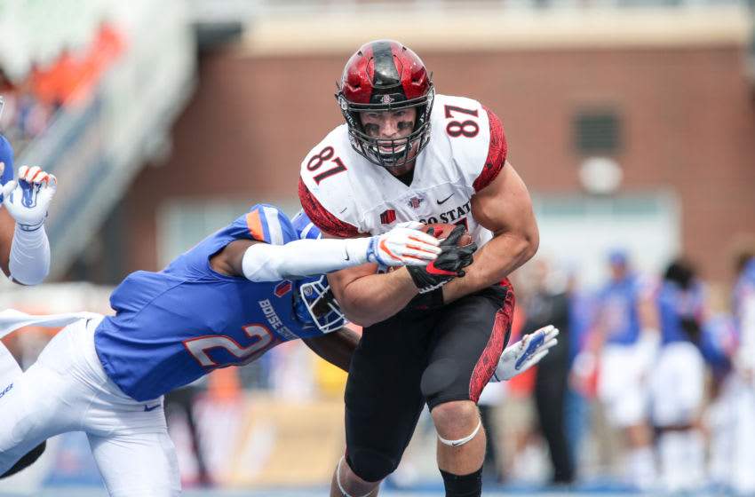 BOISE, ID - OCTOBER 6: Tight end Kahale Warring #87 of the San Diego State Aztecs runs for the end zone through the tackle of corner back Avery Williams #26 of the Boise State Broncos during first half action on October 6, 2018 at Albertsons Stadium in Boise, Idaho. (Photo by Loren Orr/Getty Images)