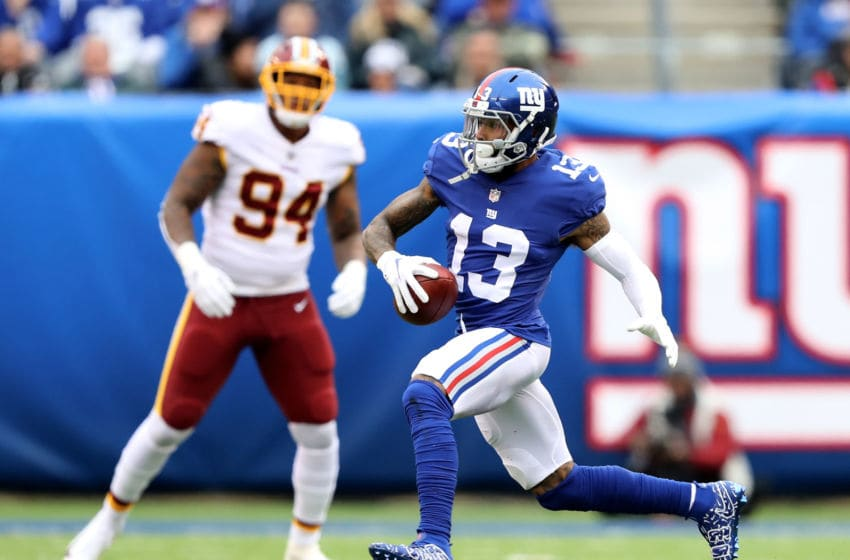 EAST RUTHERFORD, NJ - OCTOBER 28: Odell Beckham Jr. #13 of the New York Giants carries the ball as Preston Smith #94 of the Washington Redskins defends on October 28,2018 at MetLife Stadium in East Rutherford, New Jersey. (Photo by Elsa/Getty Images)