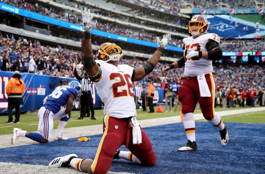 EAST RUTHERFORD, NJ - OCTOBER 28: Adrian Peterson #26 of the Washington Redskins celebrates his touchdown in the fourth quarter against the New York Giants with teammate Chase Roullier #73 on October 28,2018 at MetLife Stadium in East Rutherford, New Jersey. (Photo by Elsa/Getty Images)