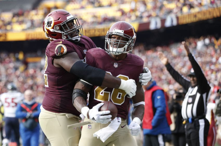 LANDOVER, MD - NOVEMBER 18: Adrian Peterson #26 of the Washington Redskins gets a hug from Jonathan Cooper #72 after rushing for a three-yard touchdown in the second quarter of the game against the Houston Texans at FedExField on November 18, 2018 in Landover, Maryland. (Photo by Joe Robbins/Getty Images)