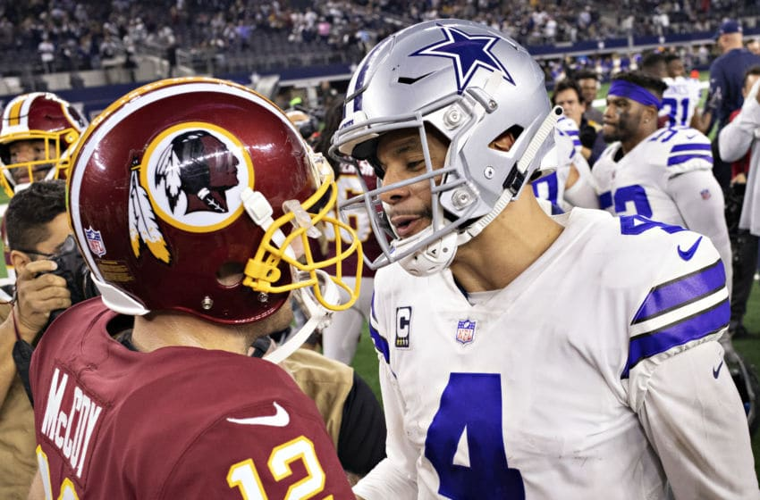 ARLINGTON, TX - NOVEMBER 22: Dak Prescott #4 of the Dallas Cowboys talks after the game with Colt McCoy #12 of the Washington Redskins at AT&T Stadium on November 22, 2018 in Arlington, Texas. (Photo by Wesley Hitt/Getty Images)