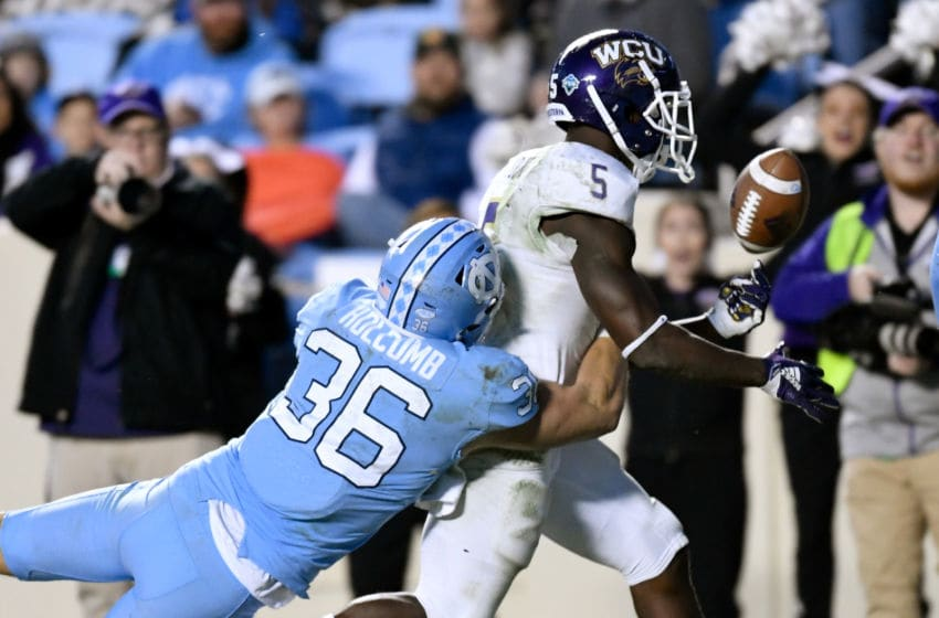 CHAPEL HILL, NORTH CAROLINA - NOVEMBER 17: Cole Holcomb #36 of the North Carolina Tar Heels forces a fumble by Connell Young #5 of the Western Carolina Catamounts during the second half of their game at Kenan Stadium on November 17, 2018 in Chapel Hill, North Carolina. (Photo by Grant Halverson/Getty Images)