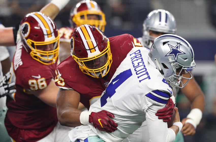 ARLINGTON, TEXAS - NOVEMBER 22: Da'Ron Payne #95 of Washington sacks Dak Prescott #4 of the Dallas Cowboys in the first quarter of a football game at AT&T Stadium on November 22, 2018 in Arlington, Texas. (Photo by Richard Rodriguez/Getty Images)