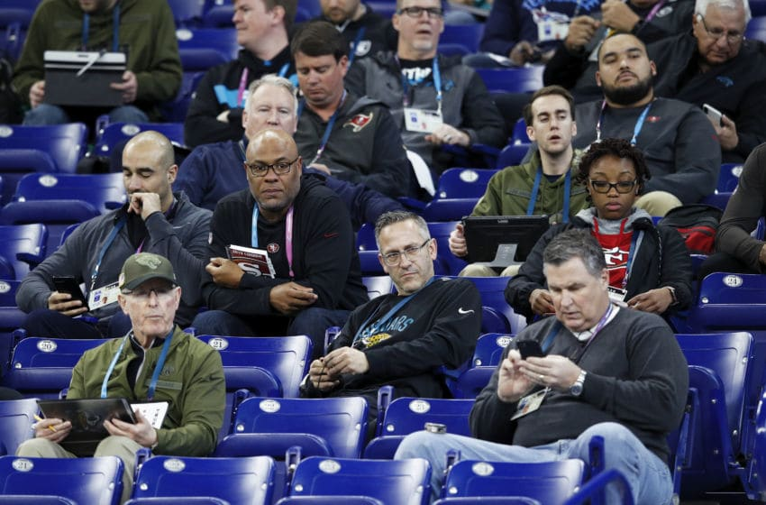 INDIANAPOLIS, IN - MARCH 01: A group of coaches and scouts from various NFL teams observe the action during day two of the NFL Combine at Lucas Oil Stadium on March 1, 2019 in Indianapolis, Indiana. (Photo by Joe Robbins/Getty Images)