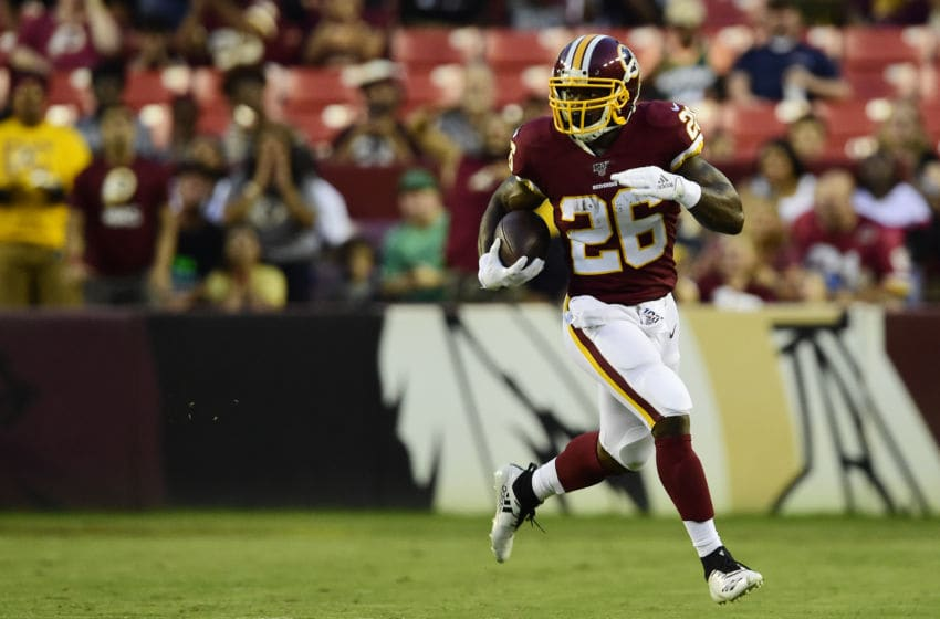 LANDOVER, MD - AUGUST 15: Adrian Peterson #26 of the Washington Redskins rushes with the ball in the first quarter against the Cincinnati Bengals during a preseason game at FedExField on August 15, 2019 in Landover, Maryland. (Photo by Patrick McDermott/Getty Images)