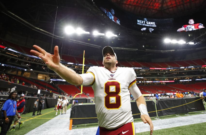 ATLANTA, GA - AUGUST 22: Quarterback Case Keenum #8 of the Washington Redskins throw his gloves to fans at the conclusion of an NFL preseason game against the Atlanta Falcons at Mercedes-Benz Stadium on August 22, 2019 in Atlanta, Georgia. (Photo by Todd Kirkland/Getty Images)