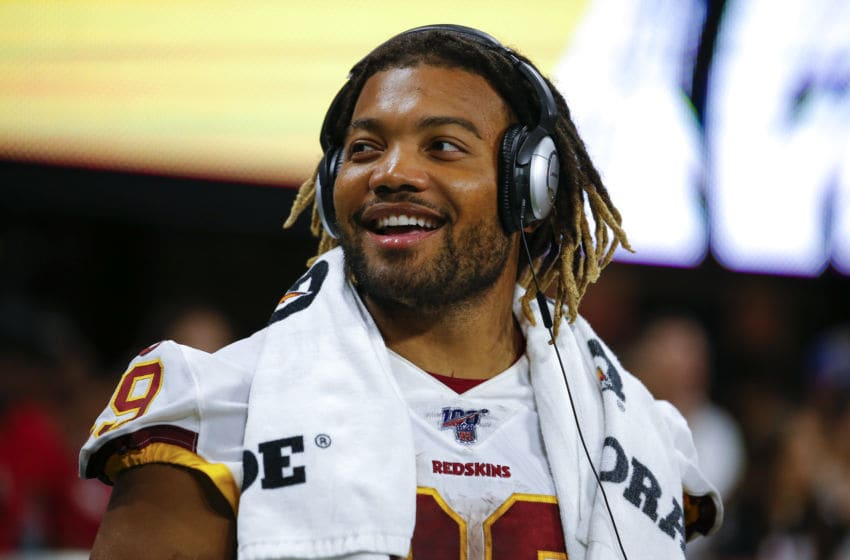 ATLANTA, GA - AUGUST 22: Running back Derrius Guice #29 of the Washington Redskins has a laugh from the sidelines in the second half of an NFL preseason game against the Atlanta Falcons at Mercedes-Benz Stadium on August 22, 2019 in Atlanta, Georgia. (Photo by Todd Kirkland/Getty Images)